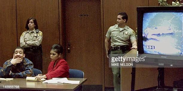 Reginald Denny beating trial defendant Damian Williams and his attorney Wilma Shanks sit in court 07 December 1993 as a television monitor shows...