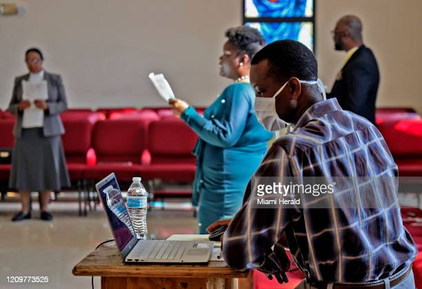 Reginald Dorival right broadcasts Sunday Easter mass with aid from Facebook and Youtube as houses of worship closed their doors but telecast their...