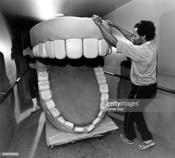 Reginald Farley of the Able Movers transportation company steadied a giant mouth as is was rolled down the hallway The Hall of Life health Education...