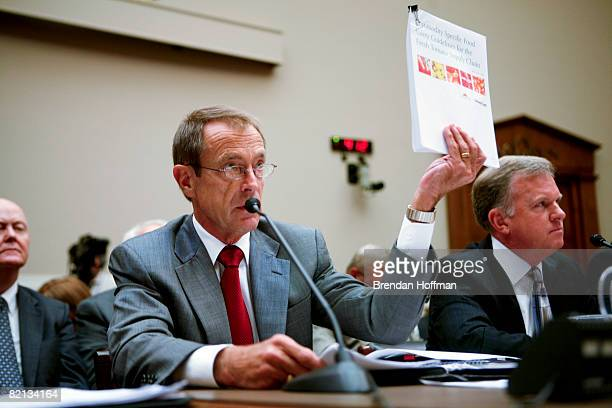 Reginald L Brown Executive Vice President of the Florida Tomato Growers Exchange displays a report on food safety guidelines during testimony on the...