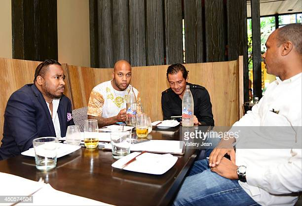 Reginald Mathis Flo Rida Alfred Culbreth and Mark Gumbel sighted dining at Bal Harbour Shops on June 13 2014 in Miami Florida