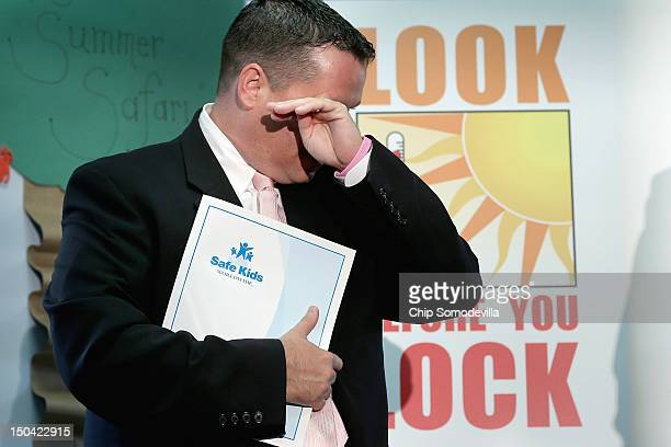 Reginald McKinnon wipes away tears after talking about his daughter's death from hyperthermia during a news conference to launch the Look Before You...