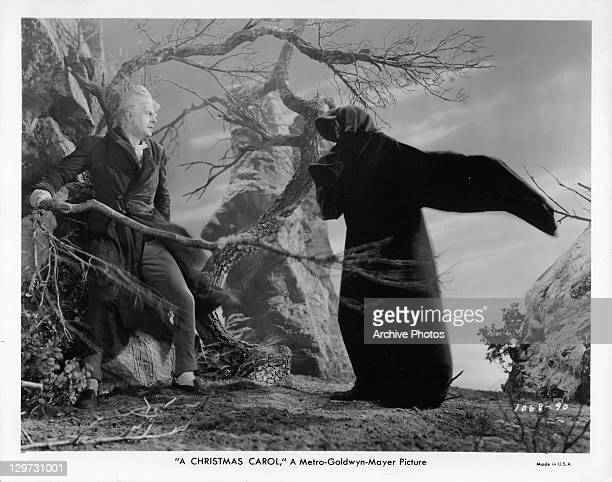 Reginald Owen frightened by D'Arcy Corrigan in a scene from the film 'A Christmas Carol' 1938