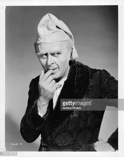 Reginald Owen with finger to mouth in a scene from the film 'A Christmas Carol' 1938