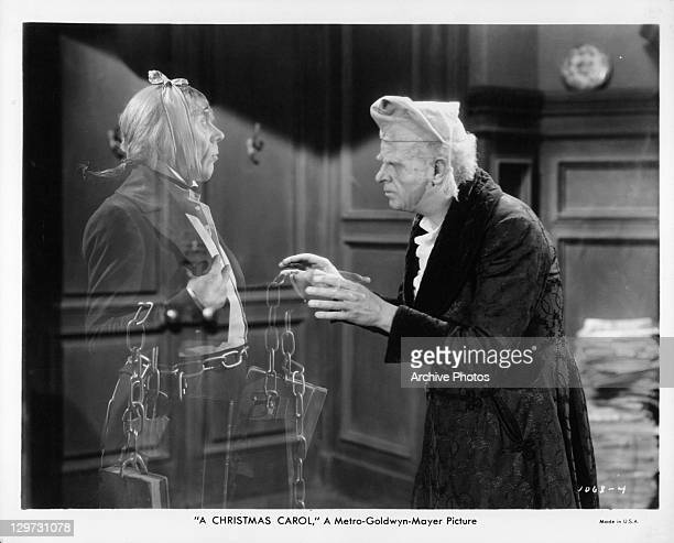 Reginald Owen with ghost in a scene from the film 'A Christmas Carol' 1938