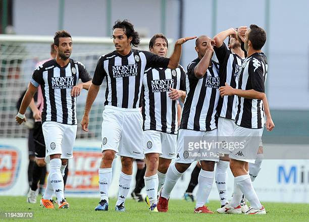 Reginaldo of Siena celebrates with teammates after scoring the opening goal of the preseason friendly match between US Citta di Palermo and Siena on...