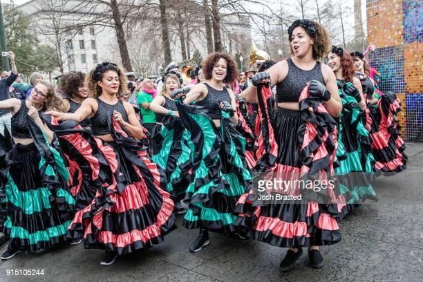 Regine Chassagne of Arcade Fire dances as the Krewe du Kanaval parades through the Treme neighborhood during the inaugural Krewe Du Kanaval on...