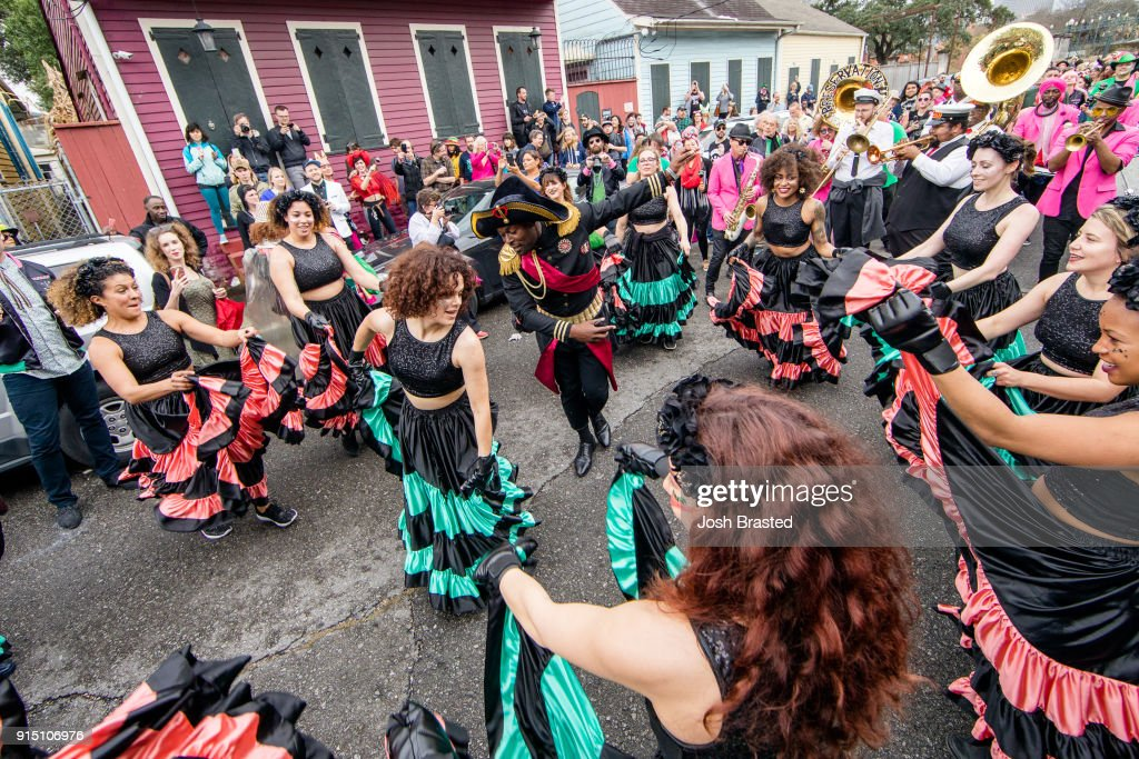 Regine Chassagne (C) of Arcade Fire dances as the Krewe du Kanaval parades through the Treme neighborhood during the inaugural Krewe Du Kanaval on February 6, 2018 in New Orleans, Louisiana.