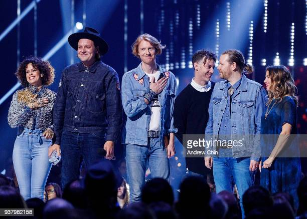 Regine Chassagnes Win Butler Richard Reed Parry Jeremy Gara and Tim Kingsbury of Arcade Fire receive the award during the 2018 JUNO Awards at Rogers...