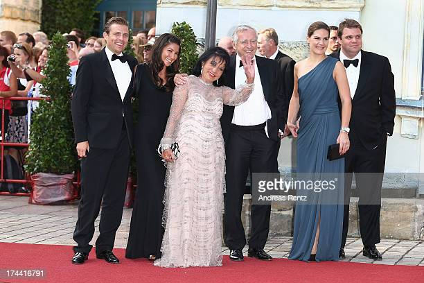Regine Sixt with her husband Erich Sixt and family members attend the Bayreuth Festival opening on July 25 2013 in Bayreuth Germany
