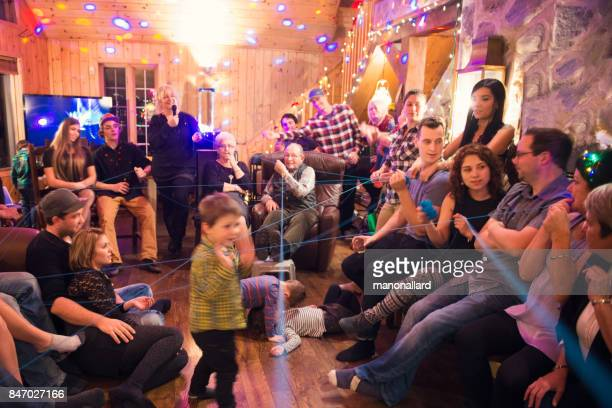 regional christmas and new year at home with family celebrating together - large family stock photos and pictures