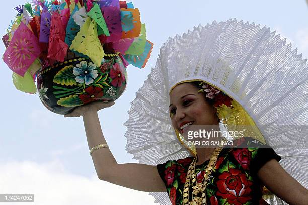 A regional dancer perfoms at the Guelaguetza festival on July 22 2013 in Oaxaca Mexico The Guelaguetza is a festival held once a year which gathers...