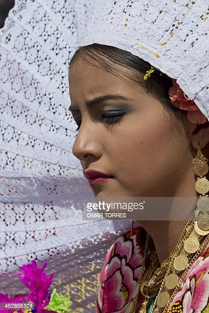 A regional dancer perfoms during the Guelaguetza celebration on July 28 2014 in Oaxaca Mexico The Guelaguetza is a festival held once a year that...