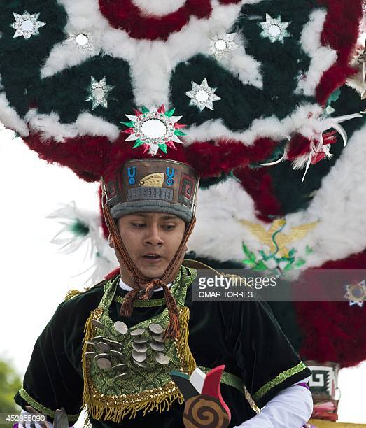 Regional dancers perfom during the Guelaguetza celebration on July 28 2014 in Oaxaca Mexico The Guelaguetza is a festival held once a year that...