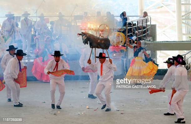 Regional dancers perform at the Guelaguetza Festival in Oaxaca Mexico on July 22 2019 The annual Guelaguetza Festival gathers music dance gastronomy...