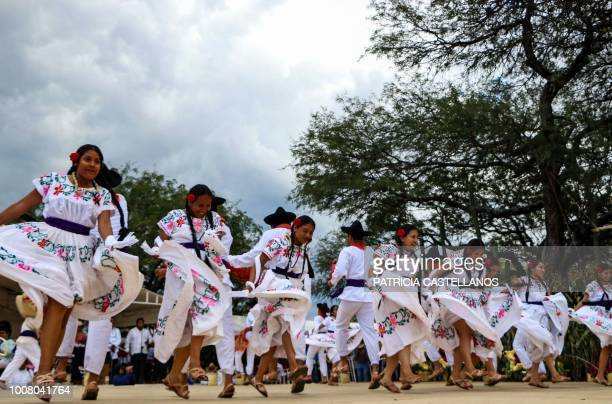 Regional dancers perform at the Guelaguetza festival on July 30 2018 in Zaachila Oaxaca Mexico The Guelaguetza is a festival held once a year which...