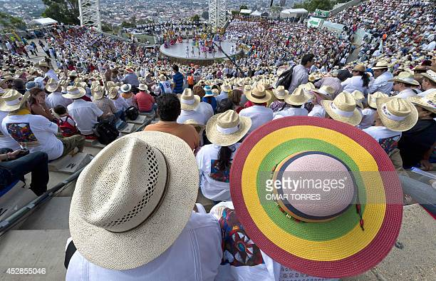 Regional dancers watch the performances during the Guelaguetza celebration on July 28 2014 in Oaxaca Mexico The Guelaguetza is a festival held once a...