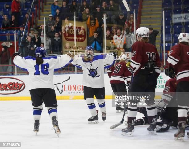 Regional girls hockey final between Greely and Lewiston Brianne Dube of Lewiston celebrates with teammate Katie Lemieux left after scoring the...