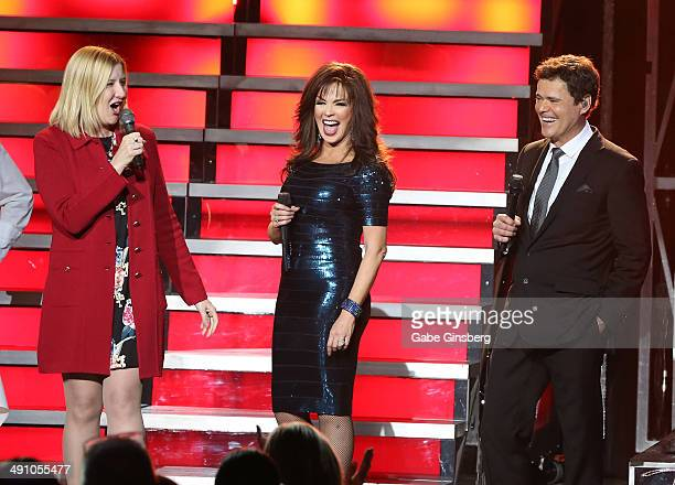 Regional President of the Flamingo Las Vegas Eileen Moore jokes around with entertainers Marie Osmond and her brother Donny Osmond during their...