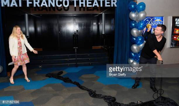 Regional President of the Linq Hotel Casino Eileen Moore watches as magician Mat Franco pulls down a curtain revealing his namesake theater marquee...