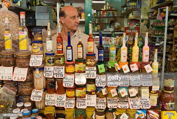Regional sauces on stall at Capo Market Palermo Sicily Italy
