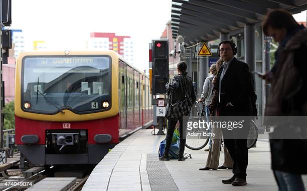 A regional SBahn train approaches passengers waiting at Alexanderplatz train station during a train strike on May 20 2015 in Berlin Germany German...