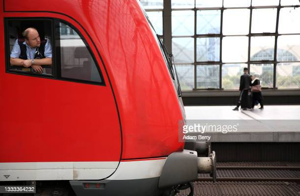 Regional train driver looks out of his window at Berlin's main train station, or Hauptbahnhof, on August 10, 2021 in Berlin, Germany. Ninety-five...