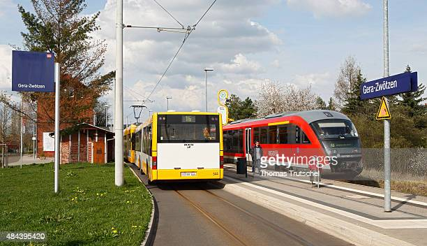 A regional train of Deutsche Bahn next to a public bus in the train station of Gera Zwoetzen on April 14 2008 in Gera Germany
