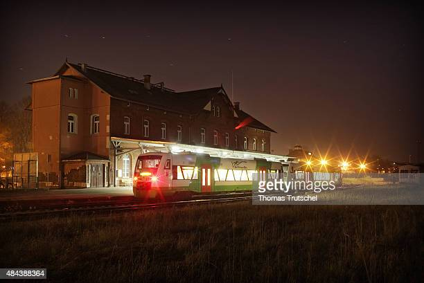 A regional Train of Sued Thueringen Bahn waits by night in front of train station of Ilmenau on December 28 2008 in Ilmenau Germany