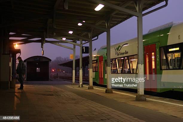 A regional train of Sued Thueringen Bahn waits during sunset in front of train station building of Ilmenau on December 29 2008 in Ilmenau Germany