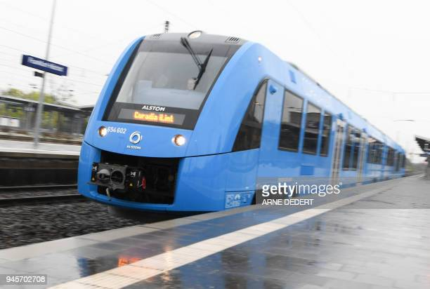 A regional train produced by French rail giant Alstom and powered by a fuel cell leaves the FrankfurtHoechst railway station in Frankfurt am Main...