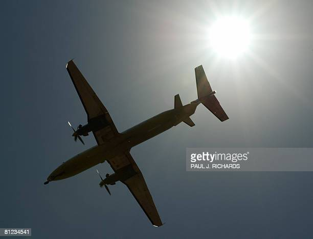 A regional turbo prop aircraft makes its final approach to Tampa International Airport May 23 in Tampa Florida AFP Photo/Paul J Richards