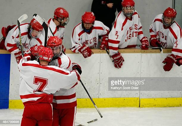 Regis celebrates their third goal of the game The Regis Jesuit High School hockey team takes on Resurrection Christian High School in the Colorado...
