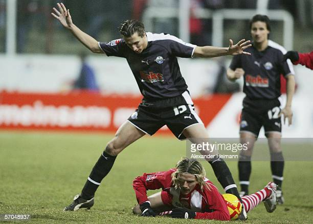 Regis Dorn of Offenbach clashes with Roel Brouwers of Paderborn during the Second Bundesliga match between Kickers Offenbach and SC Paderborn at the...