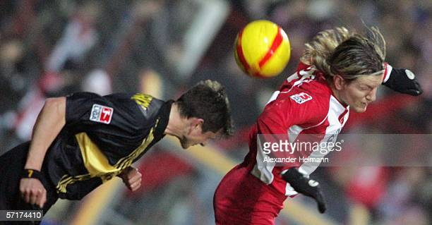 Regis Dorn of Offenbach competes with Reiner Plasshenrich of Aachen during the match of the second Bundesliga between Kickers Offenbach and Alemannia...