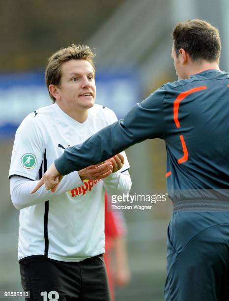 Regis Dorn of Sandhausen argues with referee Malte Dittrich pitch after been sent off and booked red card by him during the 3 Liga match between SV...