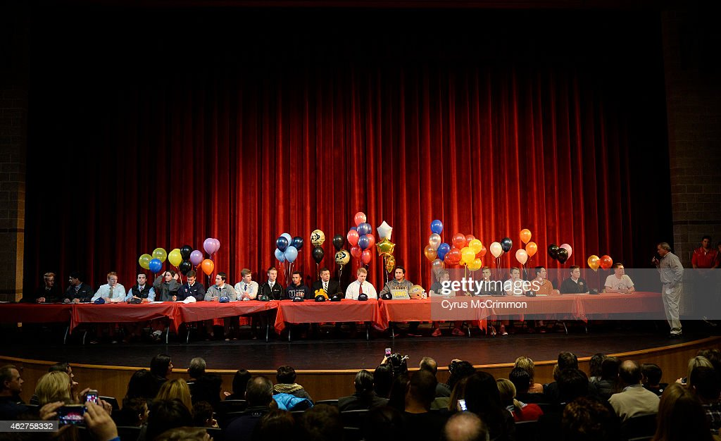 Regis High School athletes filled the stage before they signed their national letter of intent on Wednesday, February 4, 2015 in the school auditorium. They had 4 football players going to Division I programs among the 21 signees.