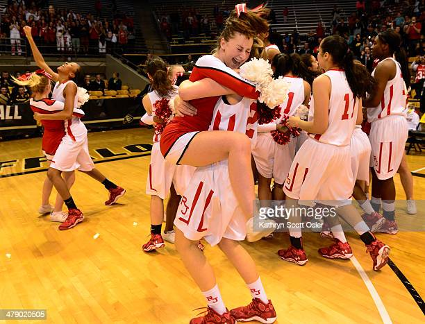 Regis Jesuit celebrates their win The Regis Jesuit Raiders take on the Fossil Ridge Sabercats in the Colorado 5A High School State Basketball...