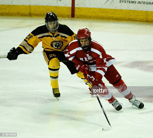 Regis Jesuit forward Michael Baer #11 gains control of the puck against Ryan Uhland #26 Monarch in the third period during the Colorado State 2016...