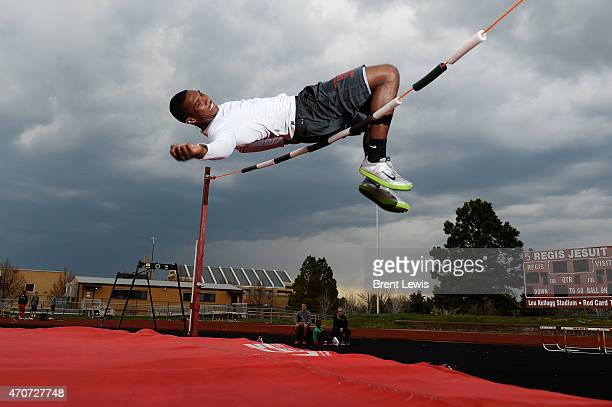 Regis Jesuit high jumper Austin Campbell gets over the bar while practice his jumps on Wednesday April 22 2015 at Regis Jesuit High School in Aurora...