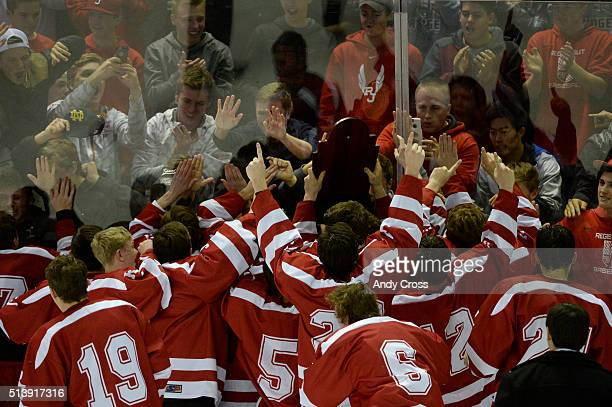 Regis Jesuit hockey players take their trophy to the fans after defeating the Monarch Coyotes 61 to win the Colorado State 2016 High School Hockey...