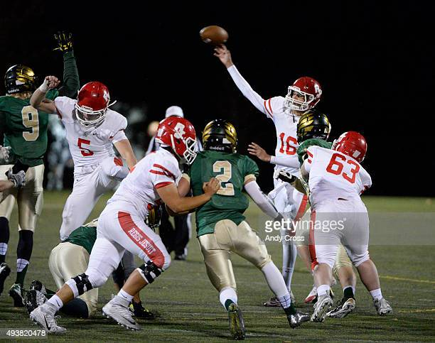 Regis Jesuit QB Justin Lamb #16 throws a strike to TE Jack Stoll for a touchdown against Mountain Vista in the first quarter at Shea Stadium October...