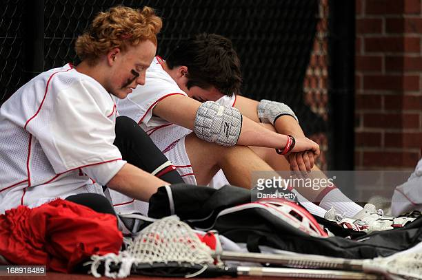 Regis Jesuit sophomore goalie Bret Quartuccio left and Regis Jesuit freshman defenseman Ian Desmond react after losing to Arapahoe High School during...