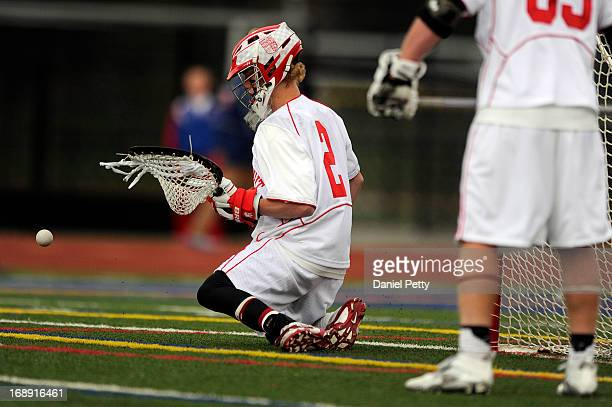 Regis Jesuit sophomore goalie Bret Quartuccio makes a save against Arapahoe High School a CHSAA 5A boys lacrosse semifinal on May 15 in Denver...