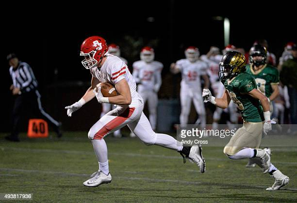 Regis Jesuit TE Jack Stoll #84 heads to the end zone for a touchdown against Nick Capocelli #20 Mountain Vista on a pass completion play from QB...