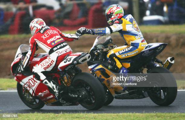 Regis Laconi of France and Troy Corser of Australia acknowledge each other as rain brings race two to a halt during race two of round two of the 2005...