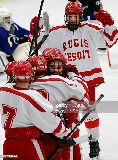 Regis players celebrate their first goal The Regis Jesuit High School hockey team takes on Resurrection Christian High School in the Colorado State...