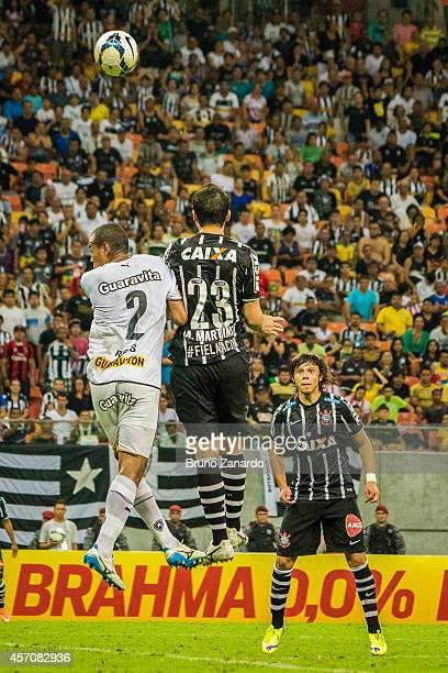 Regis Ribeiro of Botafogo and Anderson Martins of Corinthians battles for the ball during the Brasileirao Series A 2014 match between Corinthians and...