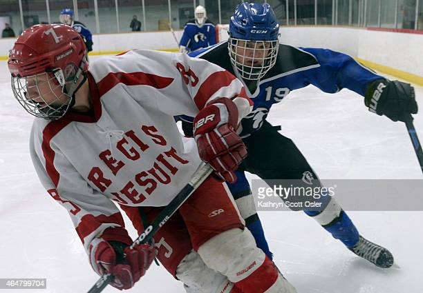Regis's Connor Brennan and Resurrection's AJ Buckner battle for the puck in the third period The Regis Jesuit High School hockey team takes on...