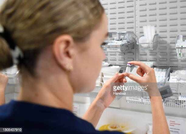 Registered Nurse Christina O'Donnell prepares a Pfizer COVID-19 vaccine at Townsville University Hospital on March 5, 2021 in Townsville, Australia....